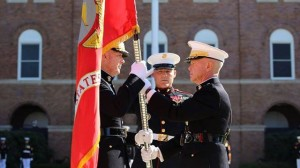Gen. James F. Amos, the 35th Commandant of the Marine Corps, passes the colors to Gen. Joseph F. Dunford, Jr., during the change of command and subsequent retirement ceremony Oct. 17, 2014 at Marine Barracks Washington, D.C. After more than 44 years of military service, Amos passed the duties as senior-ranking officer of the Marine Corps to Dunford, who has now become the 36th Commandant of the Marine Corps.